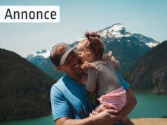far og datter foran en sø